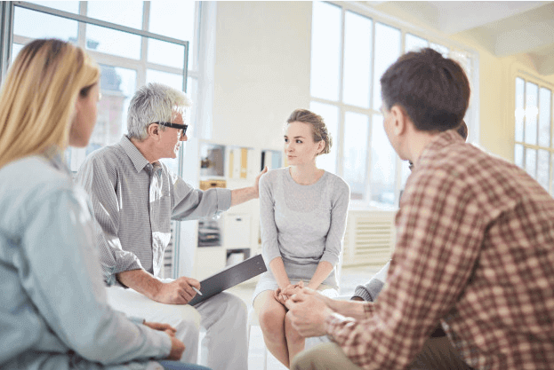 senior employee talking to young employees success institute australia